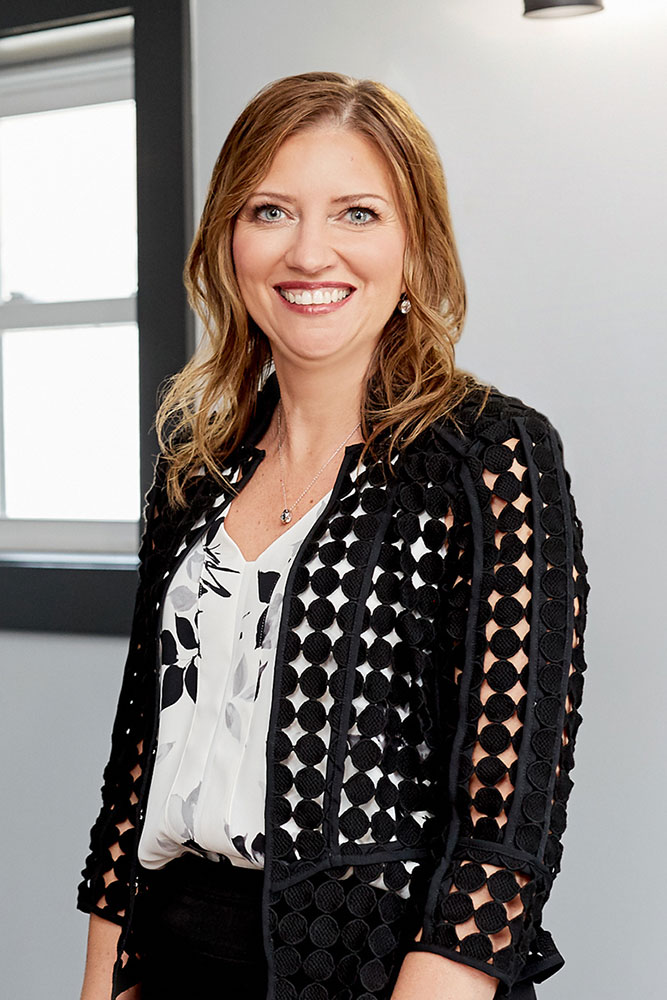 woman posing in office in front of window professional headshot