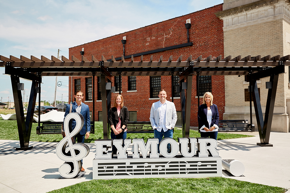 seymour team standing behind logo business photography