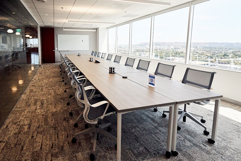 long table meeting space with large glass windows commercial photography