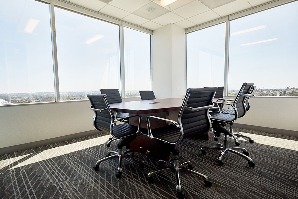 board meeting room with large glass windows commercial photography