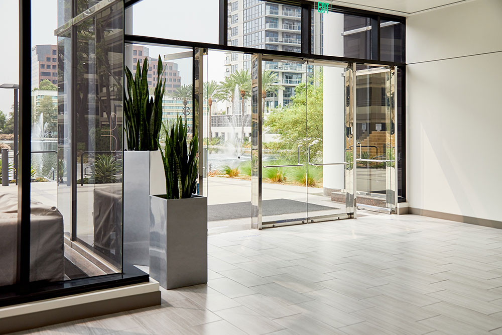 glass door entrance that exits to the city commercial photography