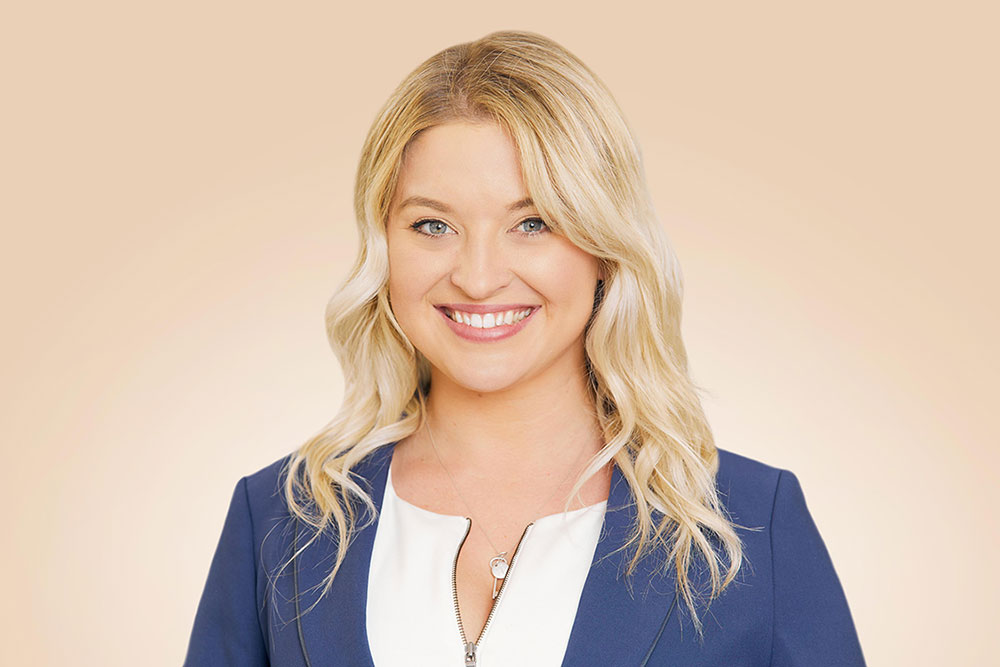 blond woman smiling for her professional headshots