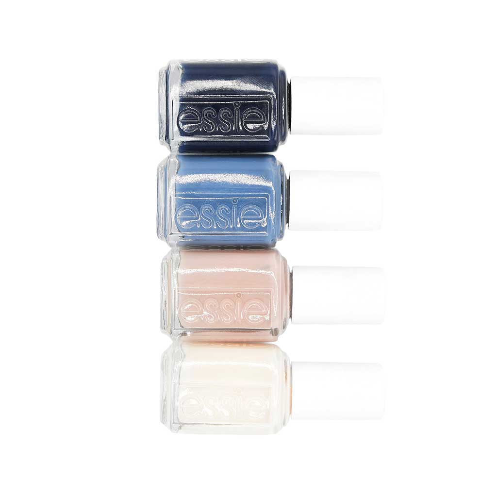 product photography of four nail polish colors with a white background